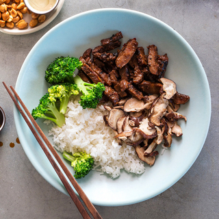 blue bowl with mongolian beef, broccoli and white rice