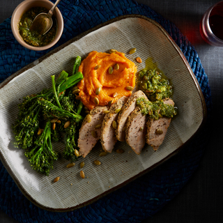 honey mustard pork tenderloin with broccolini and sweet potato mash on a rectangular dinner plate