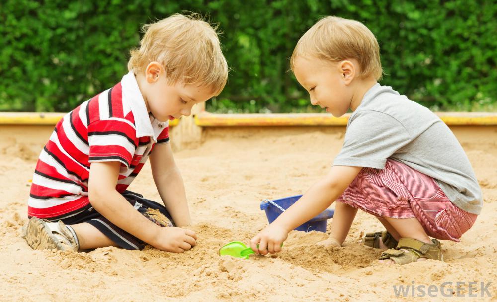two-children-playing-in-sandbox