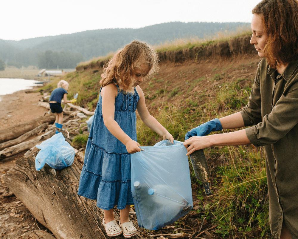 Girl removing plastic waste