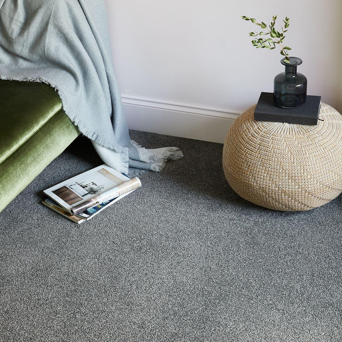 Bedroom vignette showing velvet green upholstery, baby blue tapestry and gray carpet
