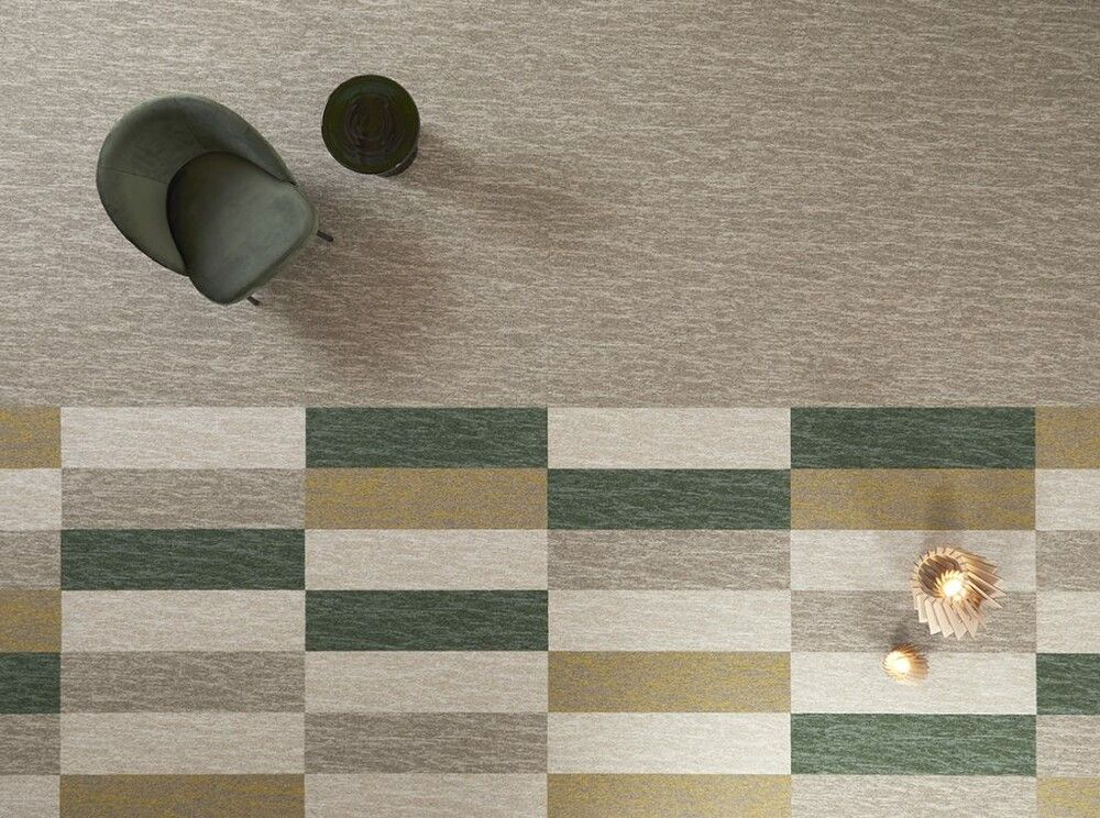 Top shot of rectangular carpet tiles in green, cream and neutral colours