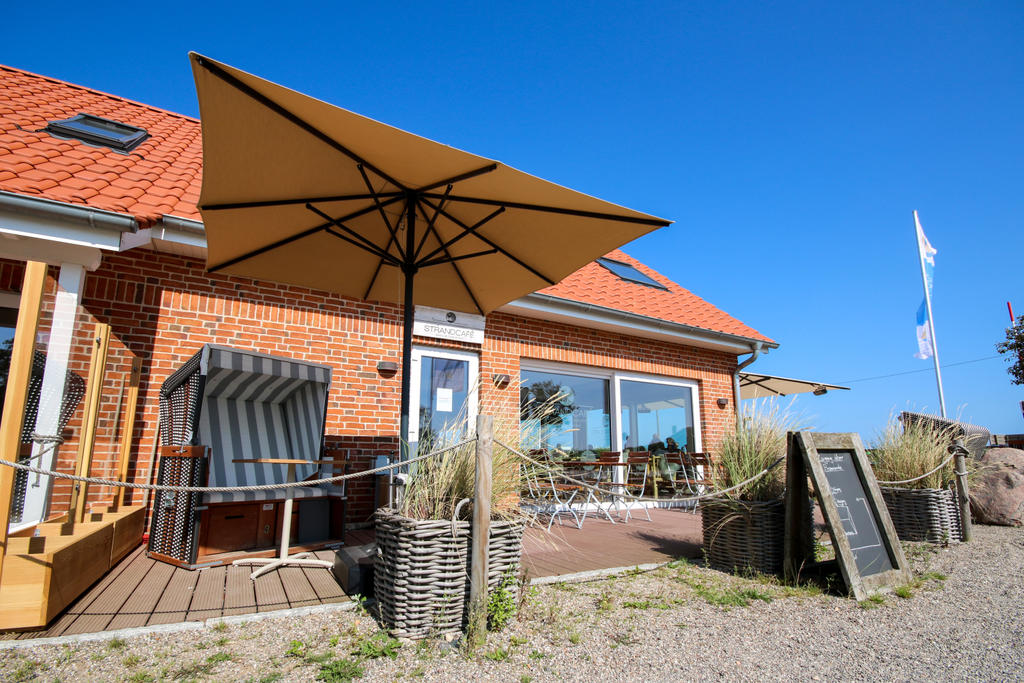 Beach terrace with white parasols