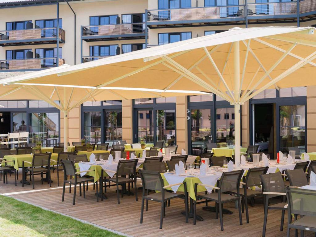 Hotel terrace with light-yellow parasols