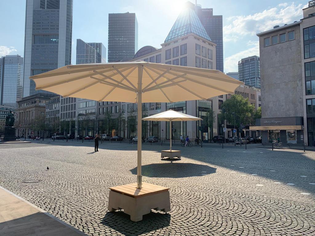 Public area with white parasols