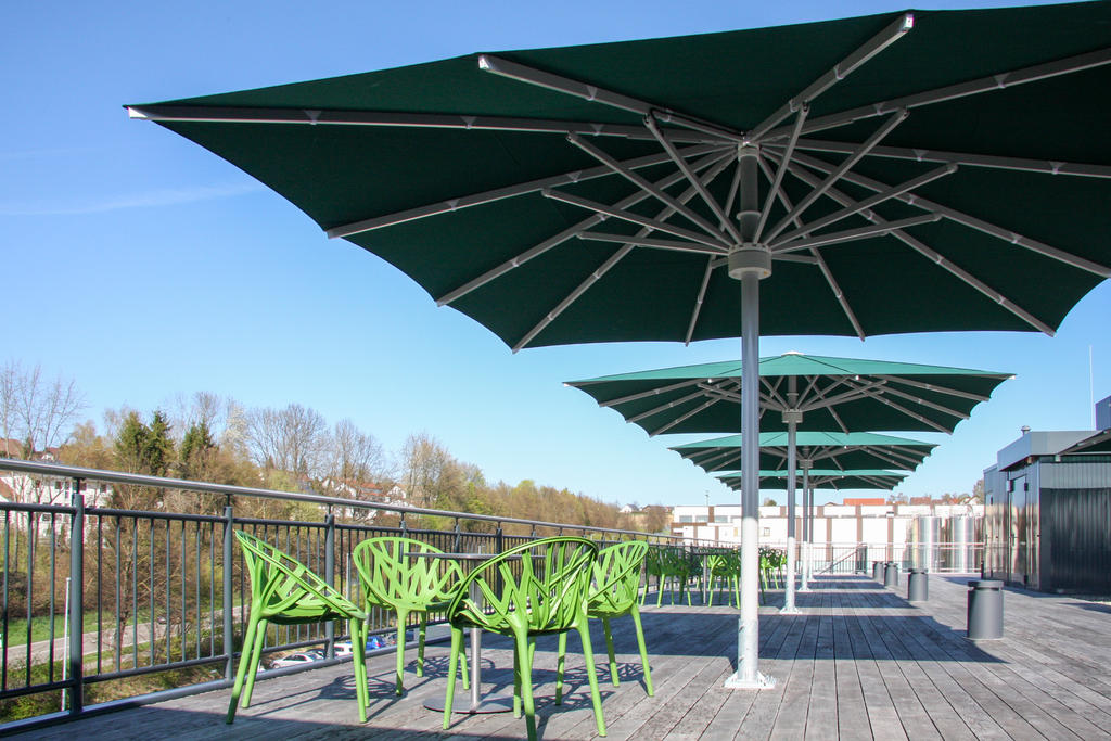 Roof terrace with green parasols