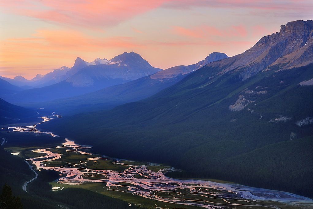 """""""Sunset Lookout"""" Photo of a mountain and valley with a river winding through it in fog at sunset."""