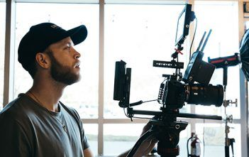 Desktop streaming Man with Blackmagic Design Camera in studio