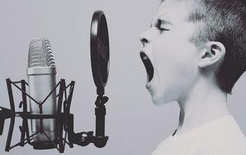 Understanding Audio Boy Singing into Microphone
