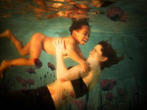 woman with child floating underwater