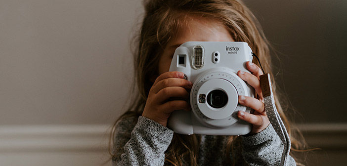 Girl holding camera up to her face