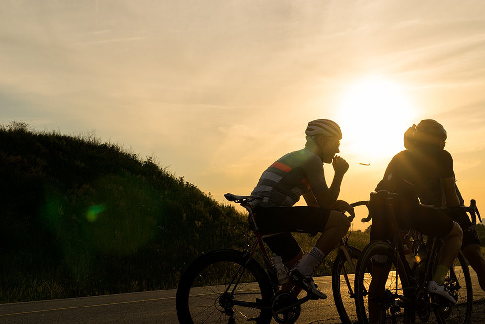 Cyclists backlit by sun © Jeff Becker