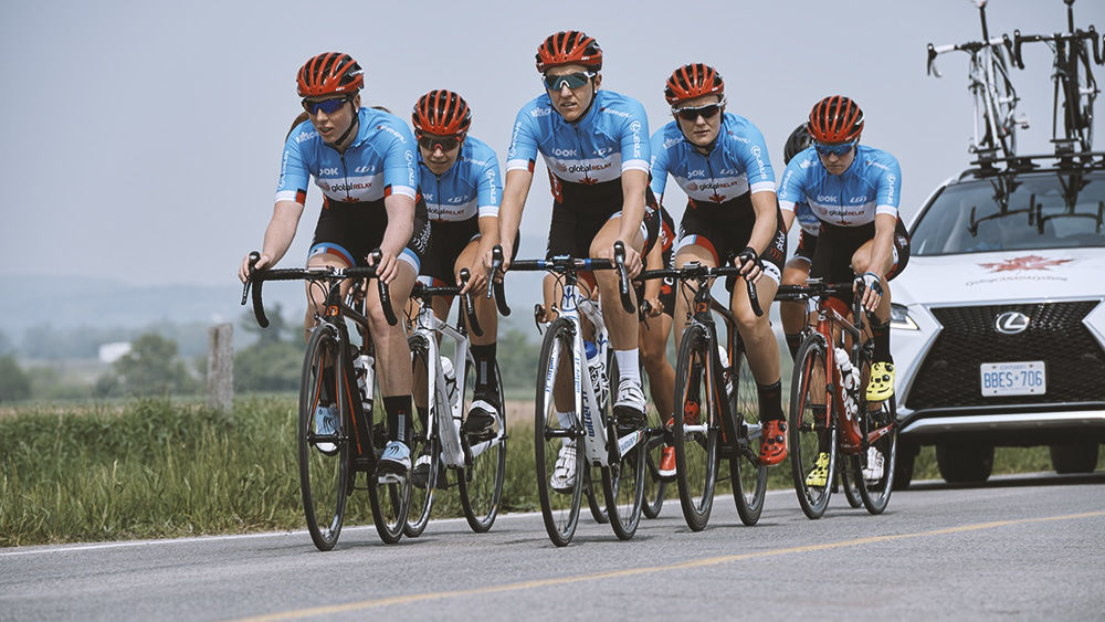 Canadian Women's Olympic Cycling Track Team riding down the road