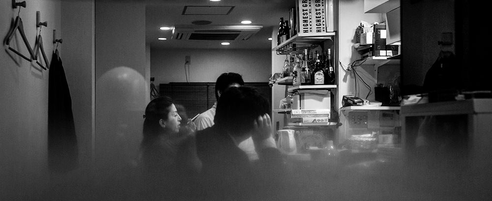 People in restaurant by Rudi Rincker