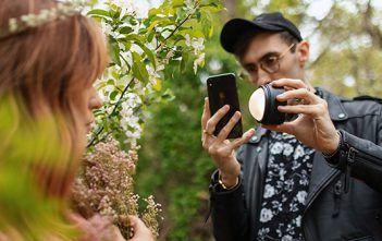 Profoto C1 Light in hands of photographer