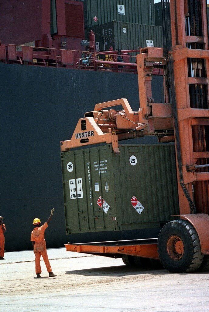 Dock Worker Guiding Container Lift Operator