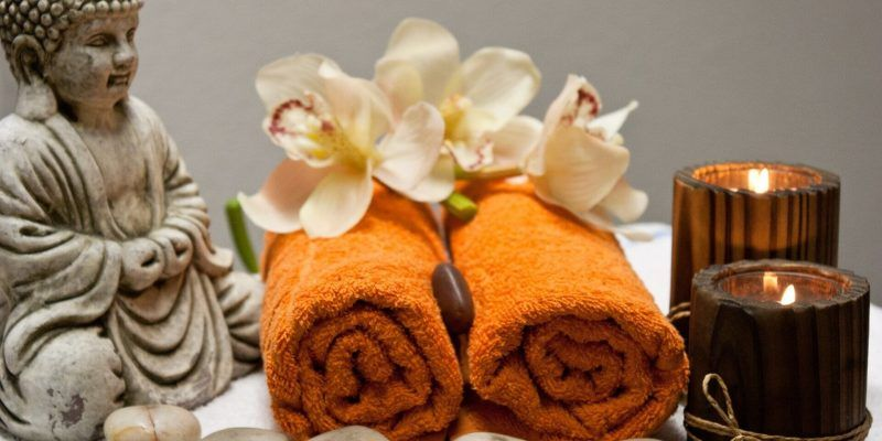 Spa towels, stones, and candles