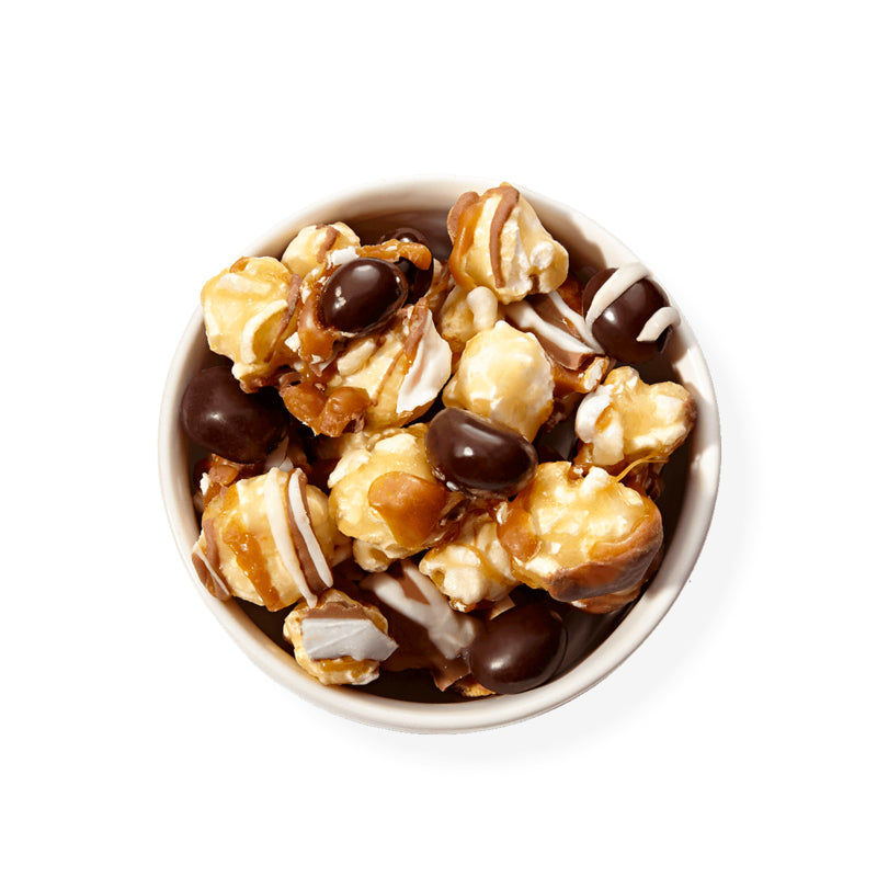 Caramel Latte-Inspired by a local coffee shop, we start with our decadent buttery caramel corn and then layer on white and milk chocolately drizzle, chewy caramel and highlight it with dark chocolate covered espresso beans. We've combined your coffee break and your snack break in one delicious treat.-Funky Chunky