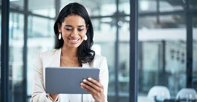 Happy smiling lady holding iPad