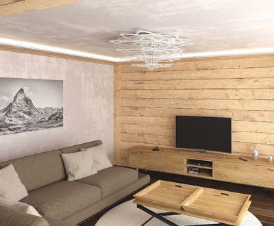 Wohnzimmer mit TV und Sofa_NevadaPrimeApartmentsZermatt