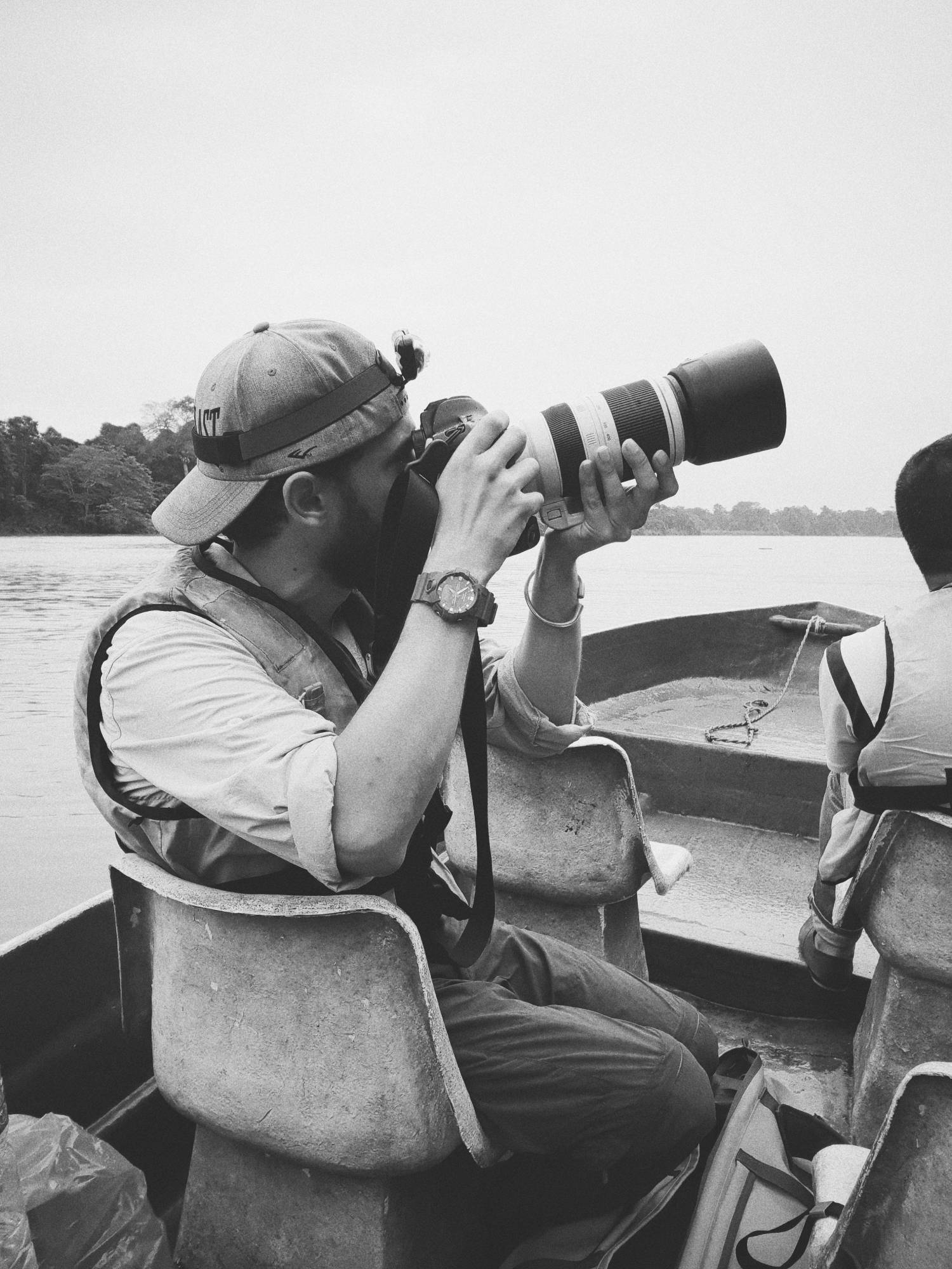 man on a boat holding a camera