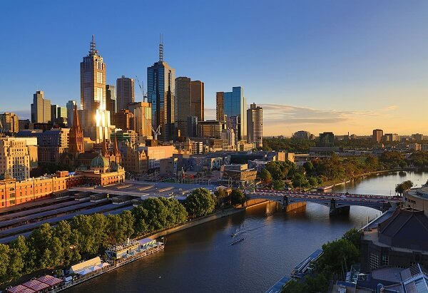 Melbourne city buildings by the Yarra River bathed in golden light, photographed with the Canon EOS RP body