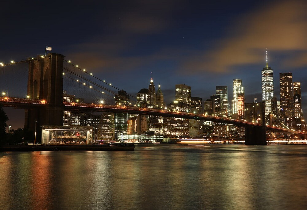 Brooklyn Bridge and New York city lit up at night, photographed with the Canon G1X Mark III compact camera