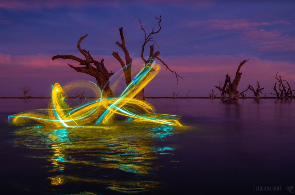 light painting photography with yellow and blue light streak