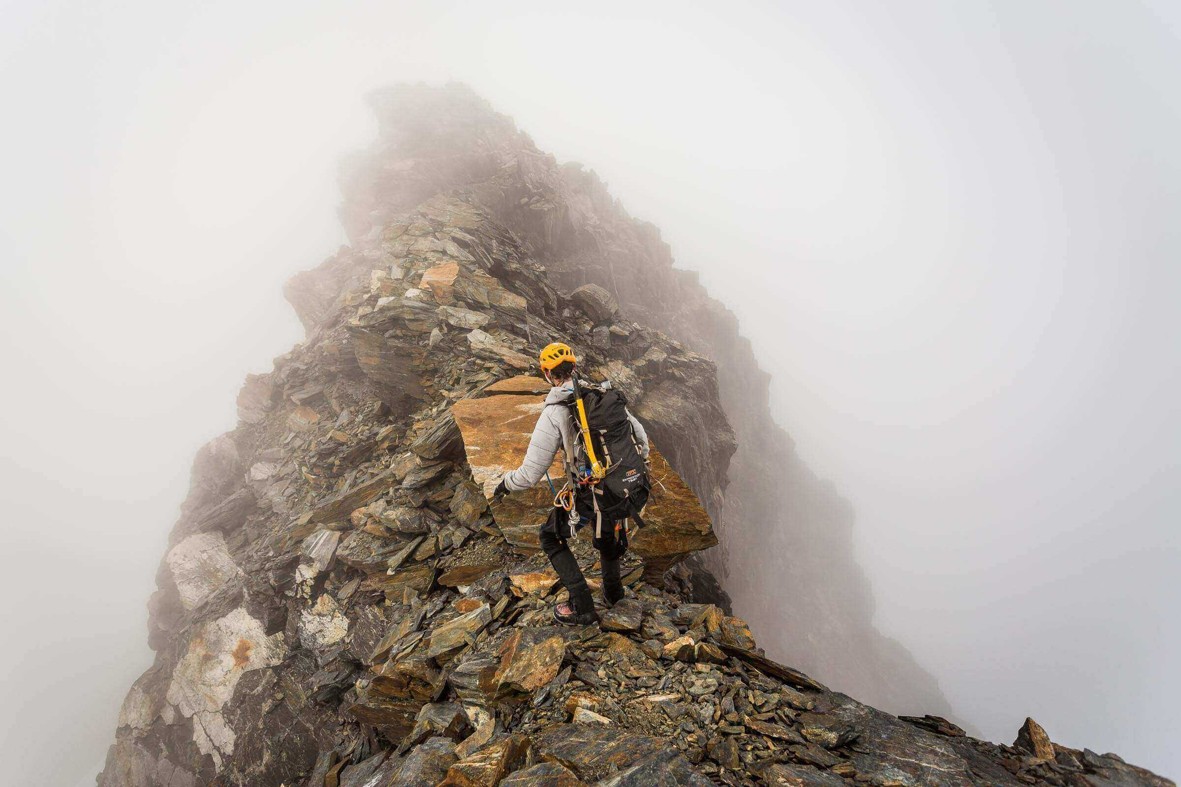 Scott Amjah traverses towards the summit of Mount Brewster in the New Zealand Alps