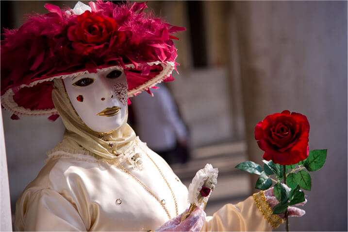 Woman wearing a venetian mask, taken with Nikon 24-120mm f/4G