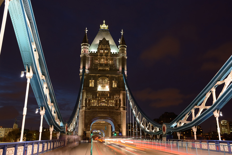 Car trails on London's Tower Bridge at night, photographed with the Nikon 18-140mm lens