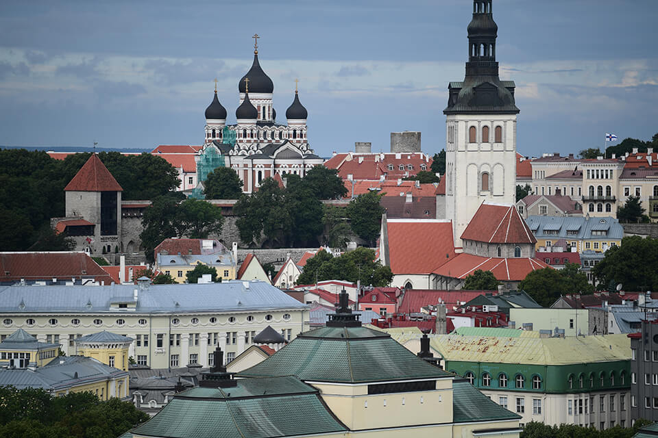 View across city buildings of Tallinn, Estonia to Alexander Nevsky Cathedral, photographed with the