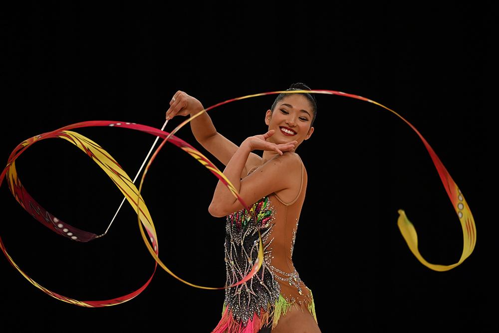 Female rhythmic gymnast twirling ribbon - shot on Nikon D6 DSLR camera