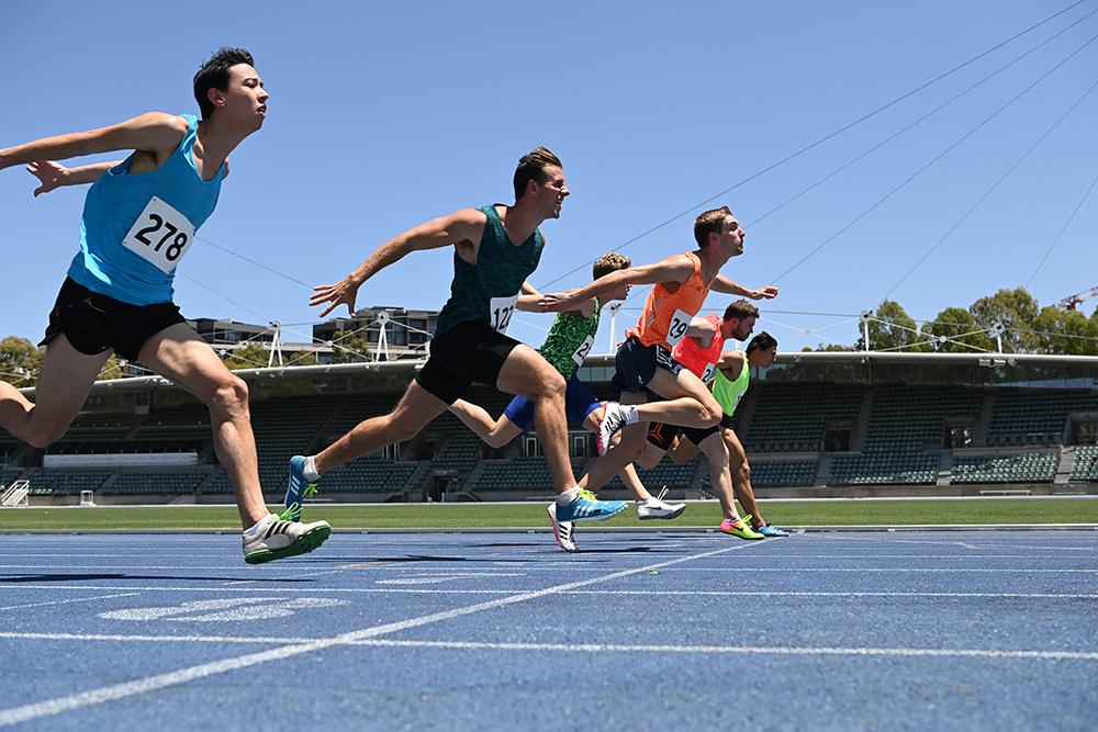 Men's track race photo finish - shot on Nikon D6 DSLR camera