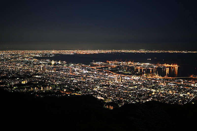 Night lights of a distant city, photographed with the Nikon Z 35mm f/1.8 S Lens