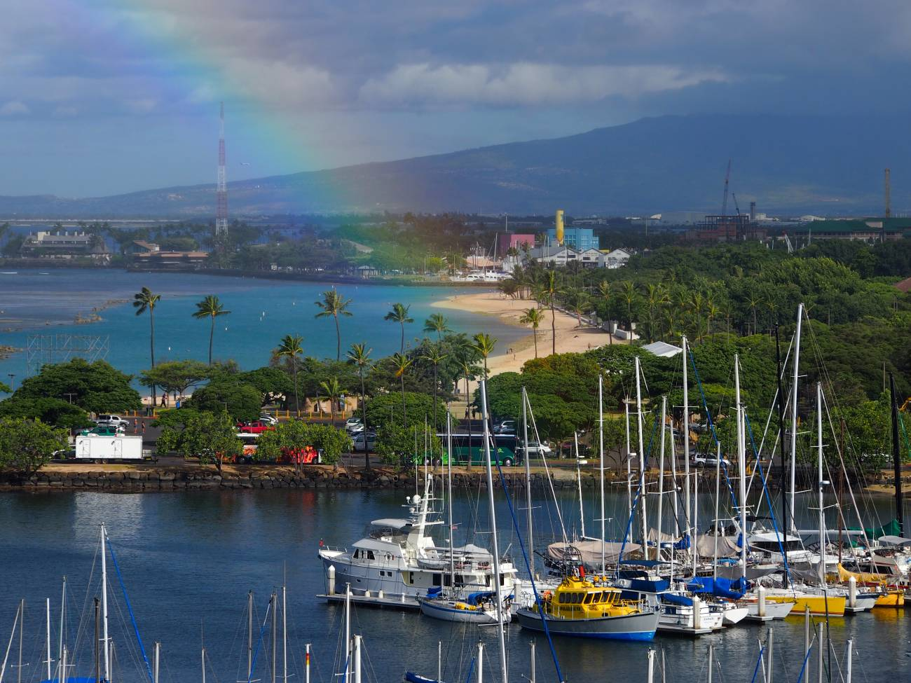 View with rainbow across boat harbour, photographed with the Olympus 40-150mm f4-5.6 R lens