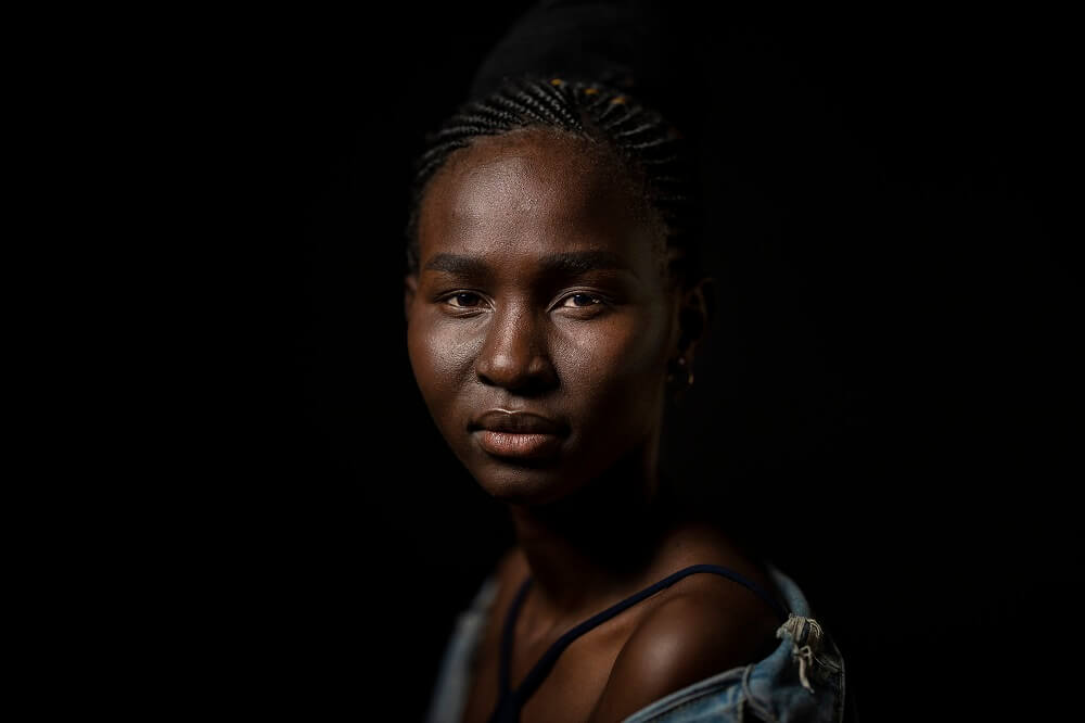 Portrait of a woman with braided hair, example of short lighting setup