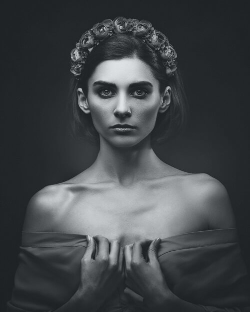 Portrait of a woman with rose headpiece, example of butterfly lighting setup