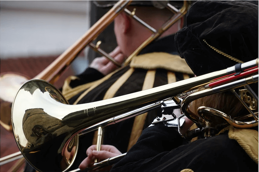Historically costumed trombone players performing, photographed with the Sony E PZ 18-105mm f/4 G OSS lens
