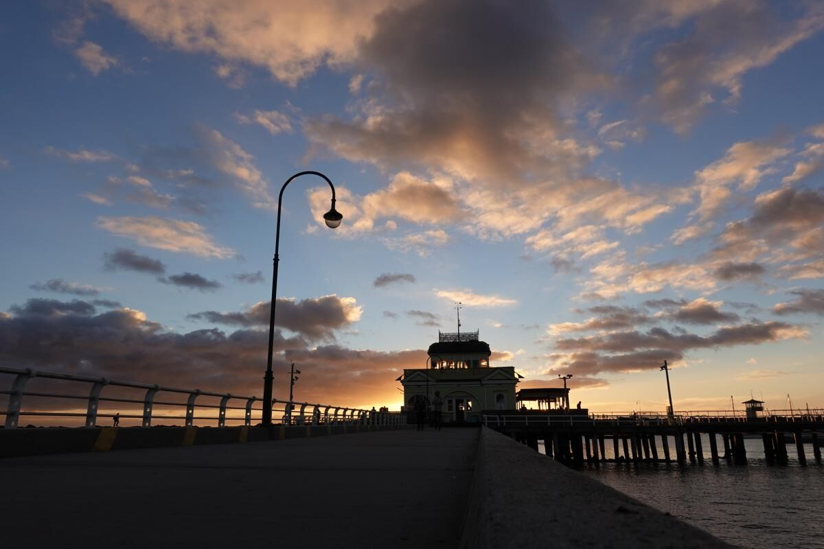 St Kilda Pier at sunset beneath a blue, cloud-filled sky, photographed with the Sony RX100 VI
