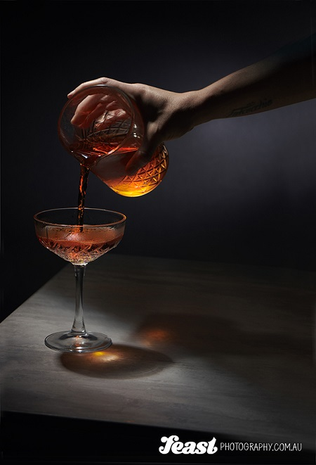 food photography pouring alcohol to a glass