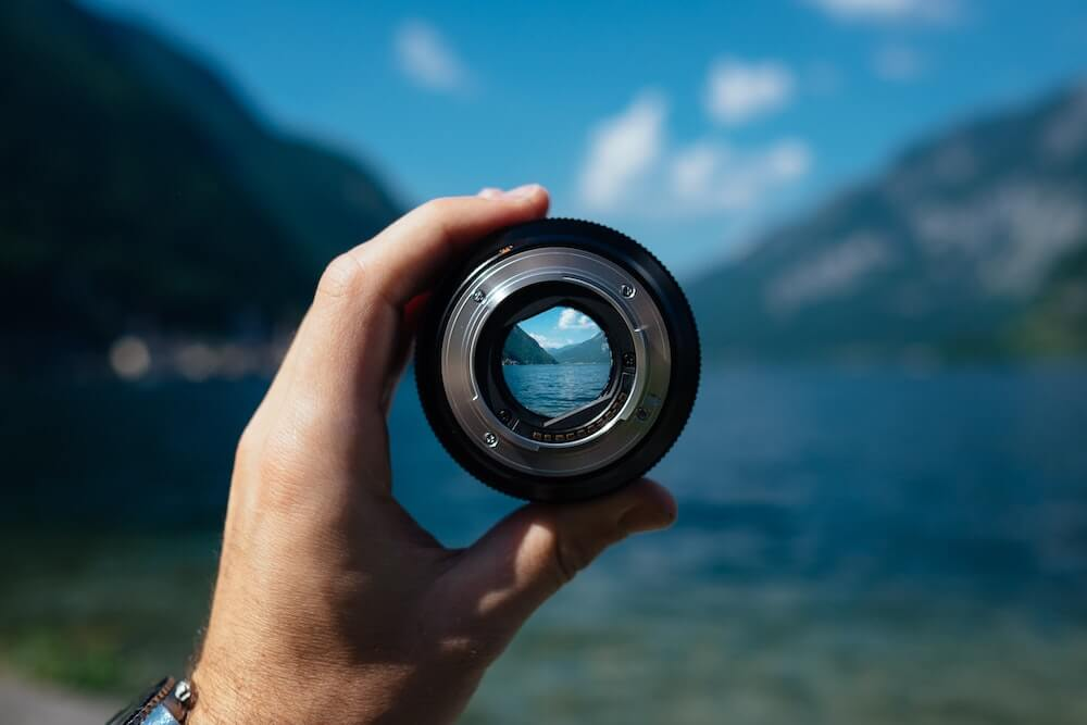 A vlogging lens pointed towards a beautiful lake