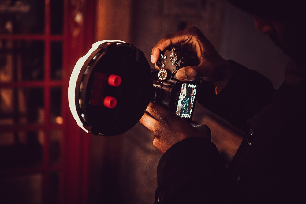 A photographer using a camera with flash