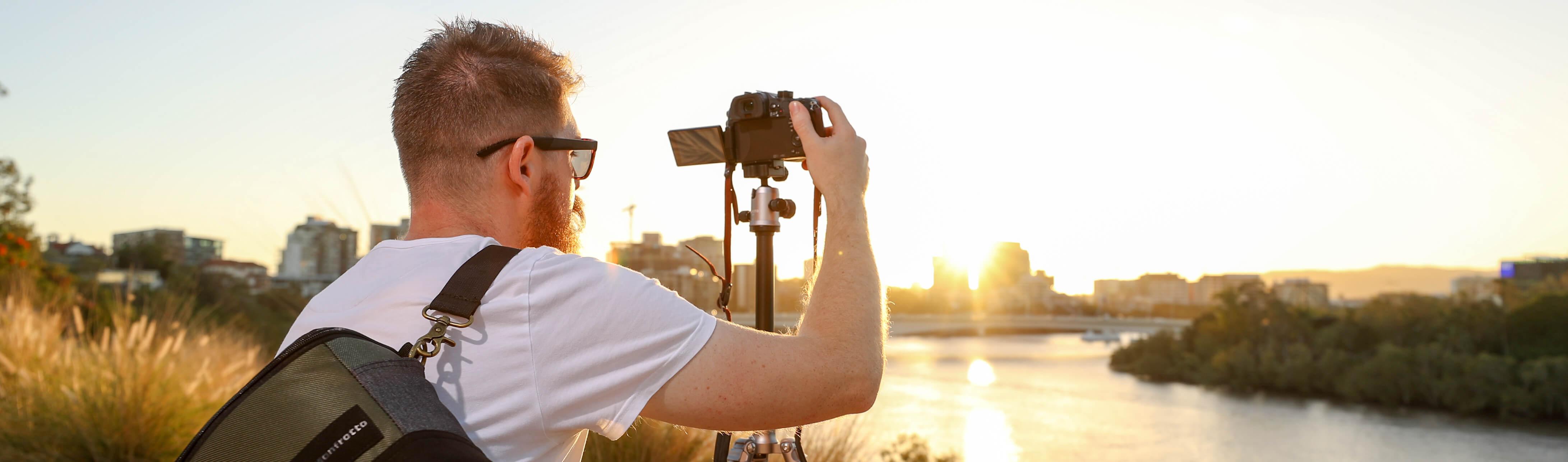 man using a mirrorless camera