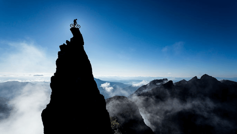Biker on top of a pinnacle rock, taken using a LEE100 Polariser Filter