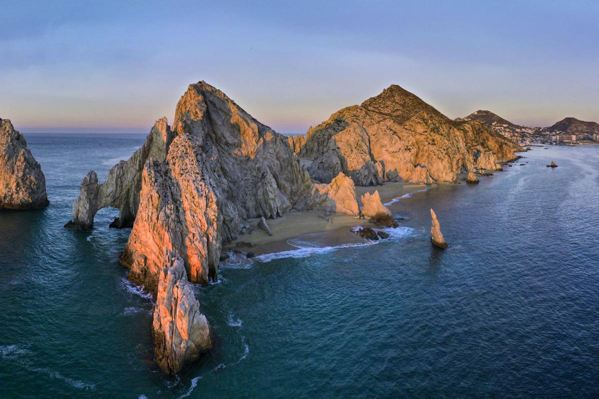 Rocky island mountains lit by the sun, shot on the DJI Mavic Air 2 drone