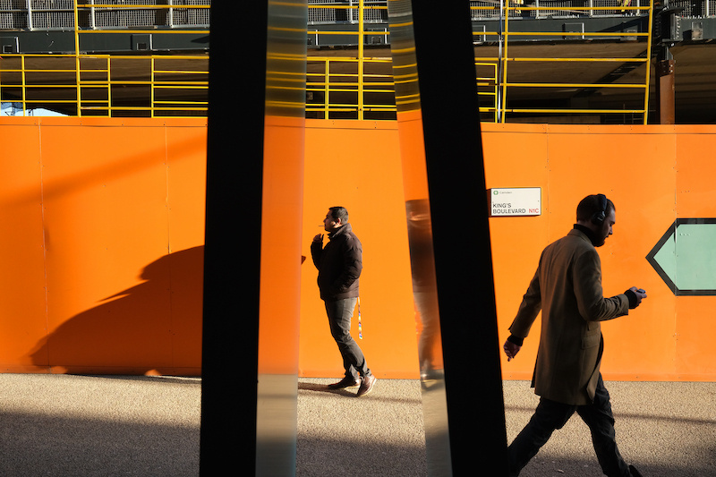 Man standing in front of an orange wall