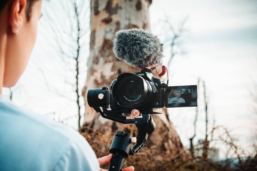 A guy holding a camera on a gimbal