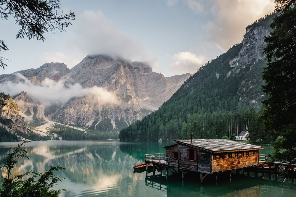 Scenic view of a cabin by the lake