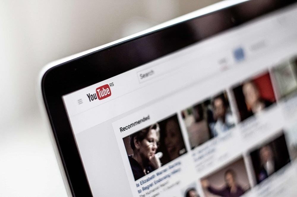 laptop showing youtube - vlogging guide